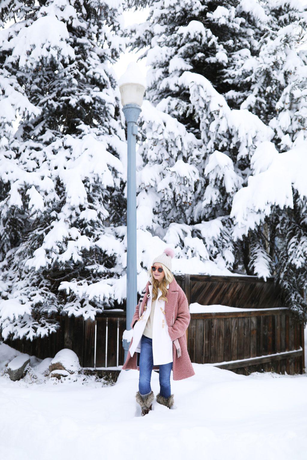 blair-eadie-aspen-outfit-ideas-cozy-pink-blush-sorel-pom-hat
